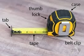 different parts of a self-return tape measure